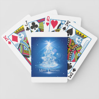 Christmas tree and light over blue background bicycle playing cards