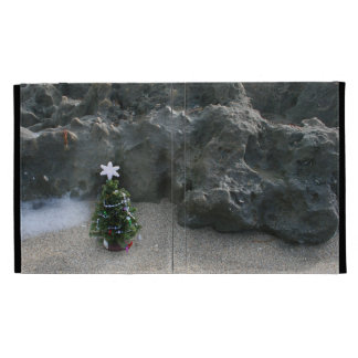 Christmas Tree In Front Of Rocks.jpg iPad Folio Covers