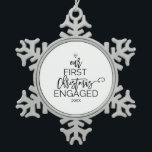 """Christmas Tree Our First Christmas Engaged Snowflake Pewter Christmas Ornament<br><div class=""""desc"""">This christmas tree """"our first christmas engaged"""" ornament is the perfect romantic christmas tree decoration and keepsake. The design features a diamond ring,  and the words """"our first christmas engaged"""" with the year all arranged to look like a christmas tree.</div>"""