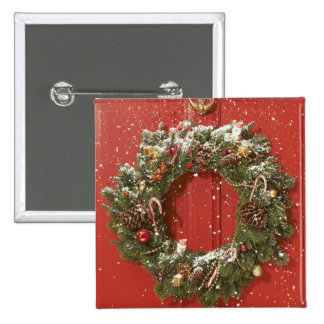 Christmas wreath hanging on a door 2 inch square button