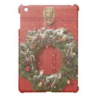 Christmas wreath hanging on a door case for the iPad mini