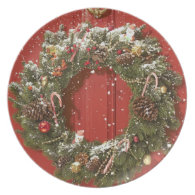 Christmas wreath hanging on a door dinner plates