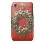 Christmas wreath hanging on a door iPhone 3 case