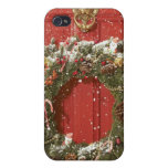 Christmas wreath hanging on a door iPhone 4 covers