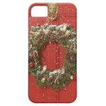 Christmas wreath hanging on a door iPhone 5 case