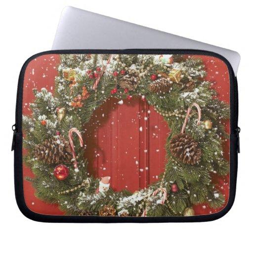 Christmas wreath hanging on a door laptop computer sleeve