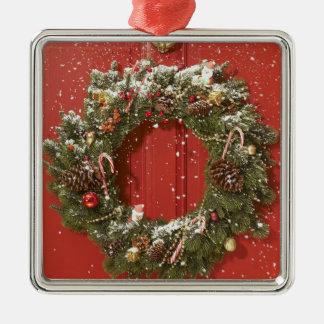 Christmas wreath hanging on a door metal ornament