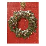 Christmas wreath hanging on a door postcard