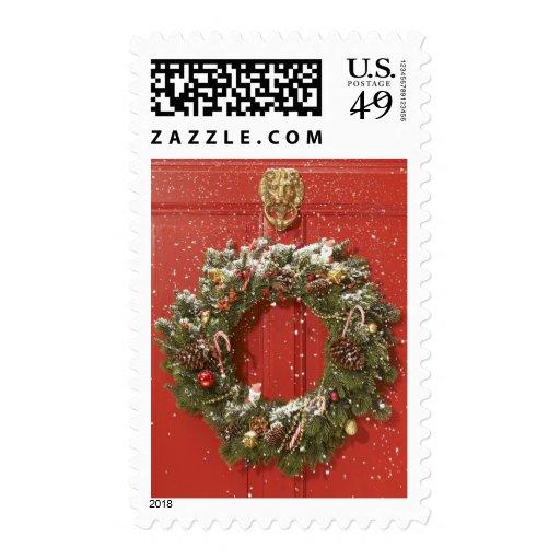 Christmas wreath hanging on a door stamps