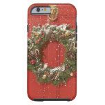 Christmas wreath hanging on a door tough iPhone 6 case