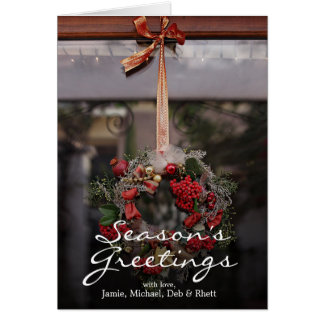 Christmas wreath hanging on a red and gold card