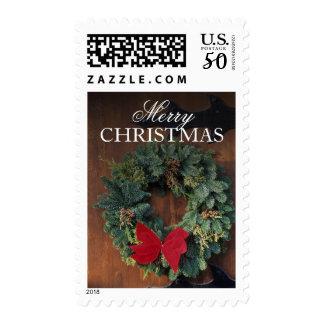 Christmas wreath on wood door postage