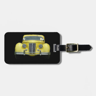 Chrome front grill of 1940's yellow antique car luggage tag