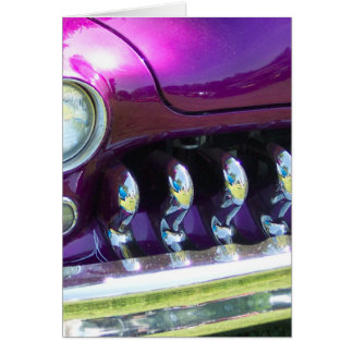 chromed out grill of a 40's classic with purple pa card
