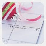 Chuchería del navidad en calendario calcomania cuadrada personalizada