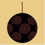 Chuchería negra y roja del navidad en color oro escultura fotográfica