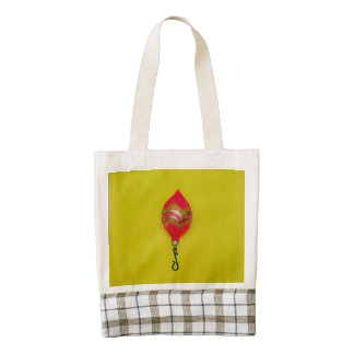Chuchería rosada del navidad en un fondo amarillo bolsa tote zazzle HEART