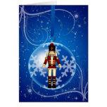 Chucherías del navidad con las estrellas y la niev