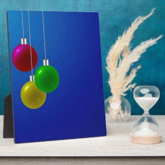Chucherías festivas del navidad placas con fotos