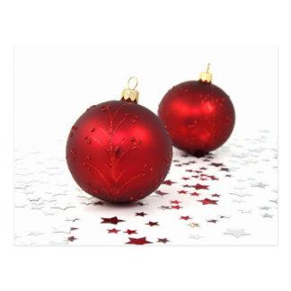 Chucherías rojas del navidad postal