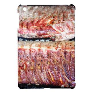 Chuletas de cerdo del cerdo en la parrilla iPad mini protectores