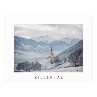 Church in Zillertal in winter white text postcard