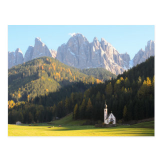 Church with Dolomites mountain background postcard