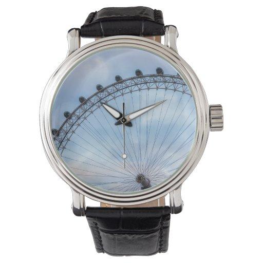 Cielo azul del ojo de Londres Relojes