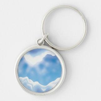 Cielo azul llavero redondo plateado