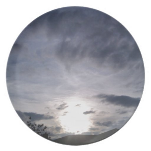 Cielo de la puesta del sol plato