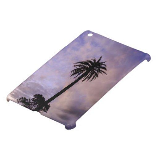 Cielo de la púrpura de la silueta de la palmera