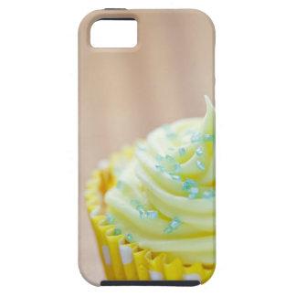 Ciérrese para arriba de la torta de la taza que iPhone 5 fundas