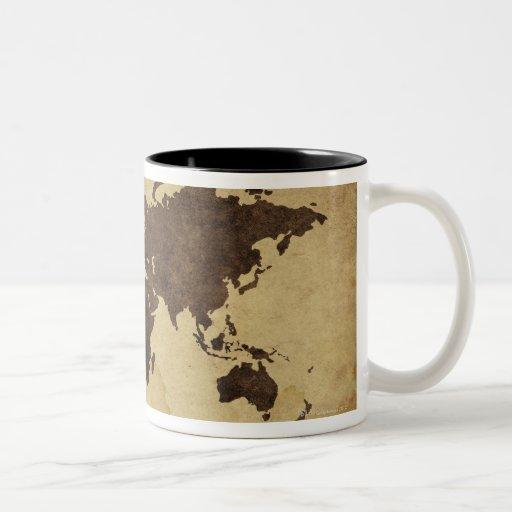 Ciérrese para arriba del mapa del mundo antiguo 3 taza de café