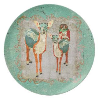 Ciervos azules y ambarinos con la placa color de r plato para fiesta