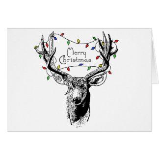 Ciervos con las luces de navidad tarjeta de felicitación