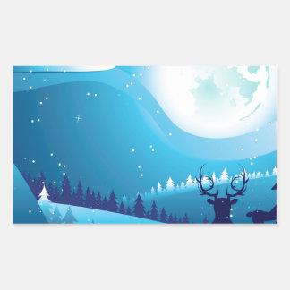 Ciervos en bosque del invierno pegatina rectangular