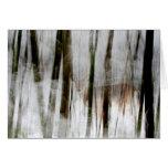Ciervos en el extracto de maderas del invierno tarjetón