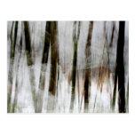Ciervos en el extracto de maderas del invierno postal