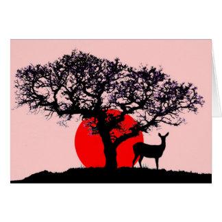 Ciervos en la puesta del sol tarjeta de felicitación