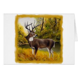 Ciervos grandes que se colocan en arboleda en prod tarjeta de felicitación