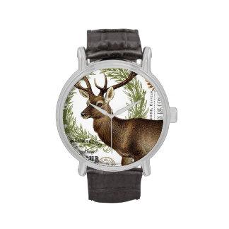 ciervos modernos del invierno del arbolado del relojes