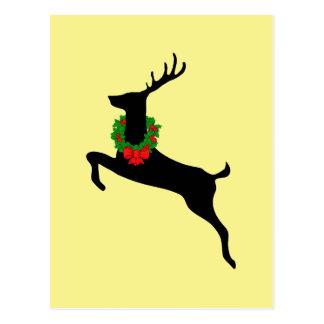 Ciervos negros de la rienda con la guirnalda del postal