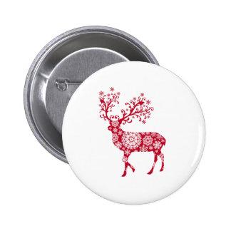 Ciervos rojos del navidad con los copos de nieve pin