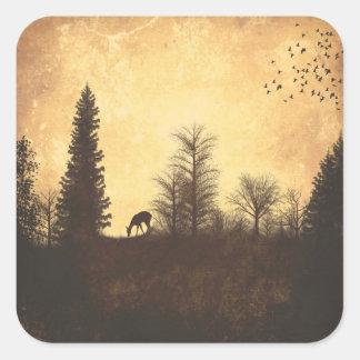 Ciervos rústicos en pegatina del país del arbolado