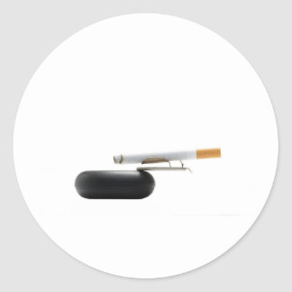 Cigarette on ashtray over white classic round sticker