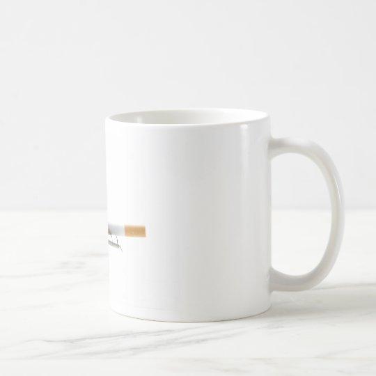 Cigarette on ashtray over white coffee mug