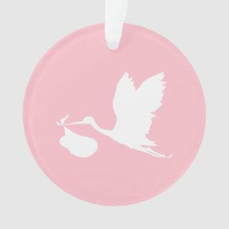 Cigüeña rosada y blanca del vuelo