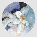 Cigüeña y bebé pegatina redonda