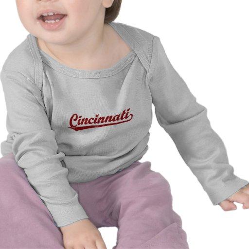Cincinnati script logo in red shirt