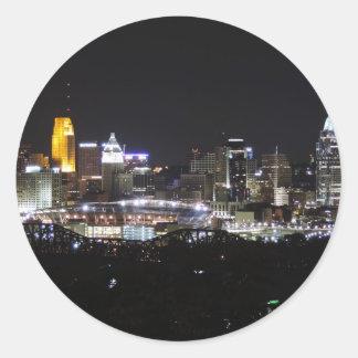 Cincinnati skyline at night classic round sticker